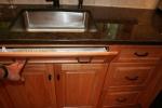 Kitchen- tilt out sink front