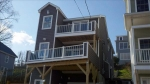 The final delivered product. The new design incorporated an additional second floor master suite deck as well as a signifcantly increased first floor deck.