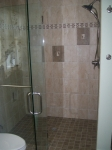 Custom Tile Shower with Glass Door in the Master Bathroom
