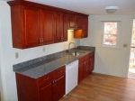 Blue Pearl Countertops with Cherry Cabinets