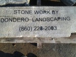 Dondero Landscaping stone that sits in a wall built by Jeff Dondero across from the Hebron Dunkin Donuts.