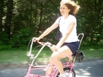 W wizzing down the hill on her pink 69 Raleigh Chopper.