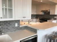 Kitchen cabinets painted, kitchen backsplash installation, painted walls, ceilings and trim.