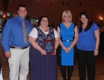 Lisbon Walmart was honored as the Supported Employment Employer of the Year. Presenting the award were David Barton, far left, of teh Supported Employment offive and Nicole Williams, far right, Director of Supported Employment. Receiving the award were Lisbon Walmart's Training Coordinator Anna McCord and Personnel Manager Deborah Varella.