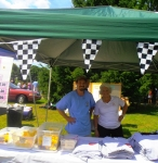 Some of our volunteers selling shirts and other souvenirs of the Duck Race.