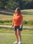 Erika Salvas tees off at the 27th Annual Gardner Johnson Memorial Golf Tournament.