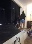 sweeping off the stage